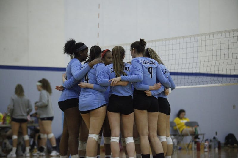 UNC's club volleyball team making a game plan during their match against Elon at their NCVF Ranking Tournament in Fetzer Gymnasium on Saturday, Feb. 23, 2019.