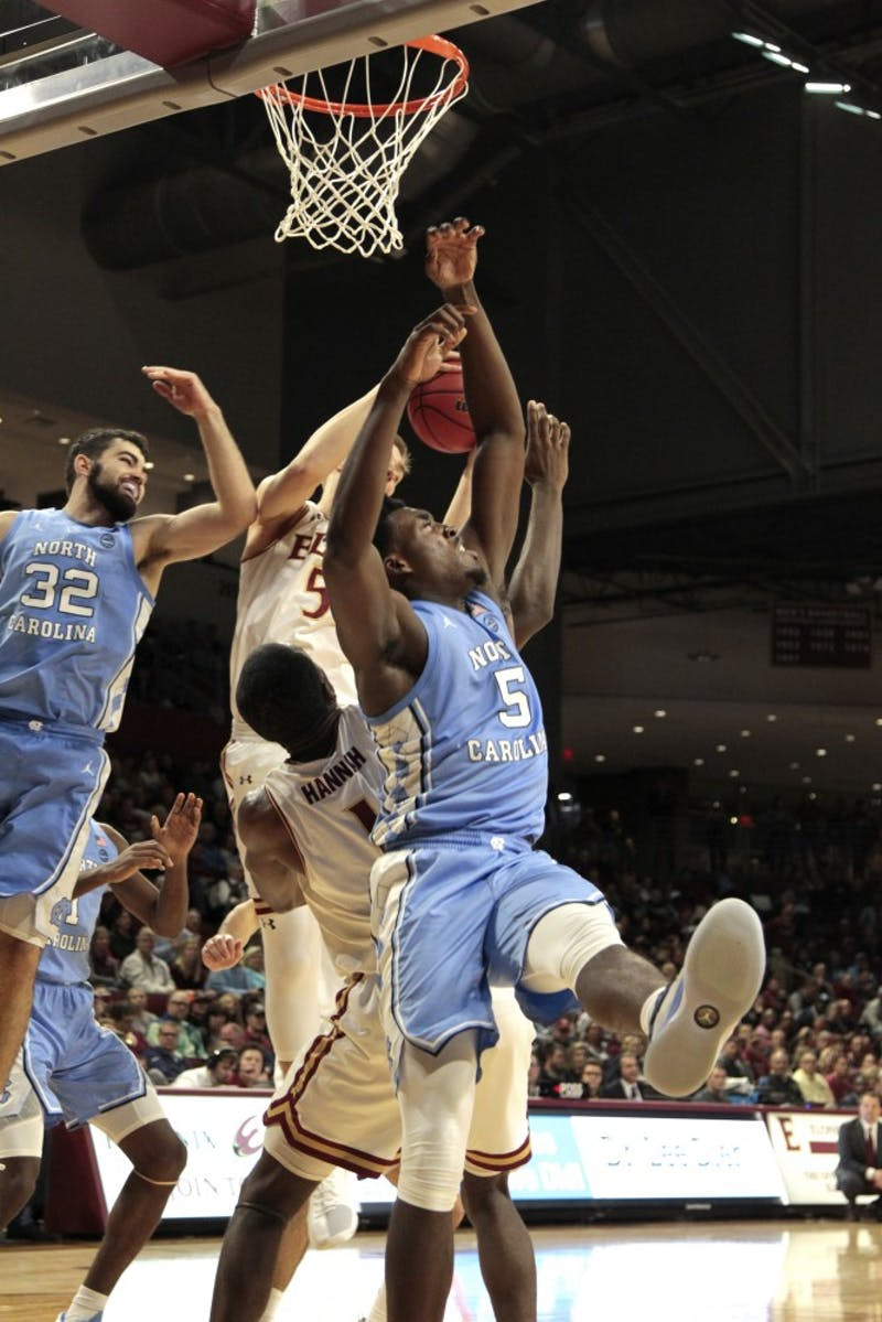 First-year Nassir Little (5) fights for the rebound at Elon. UNC beat Elon 116-67 at the Schar Center at Elon.