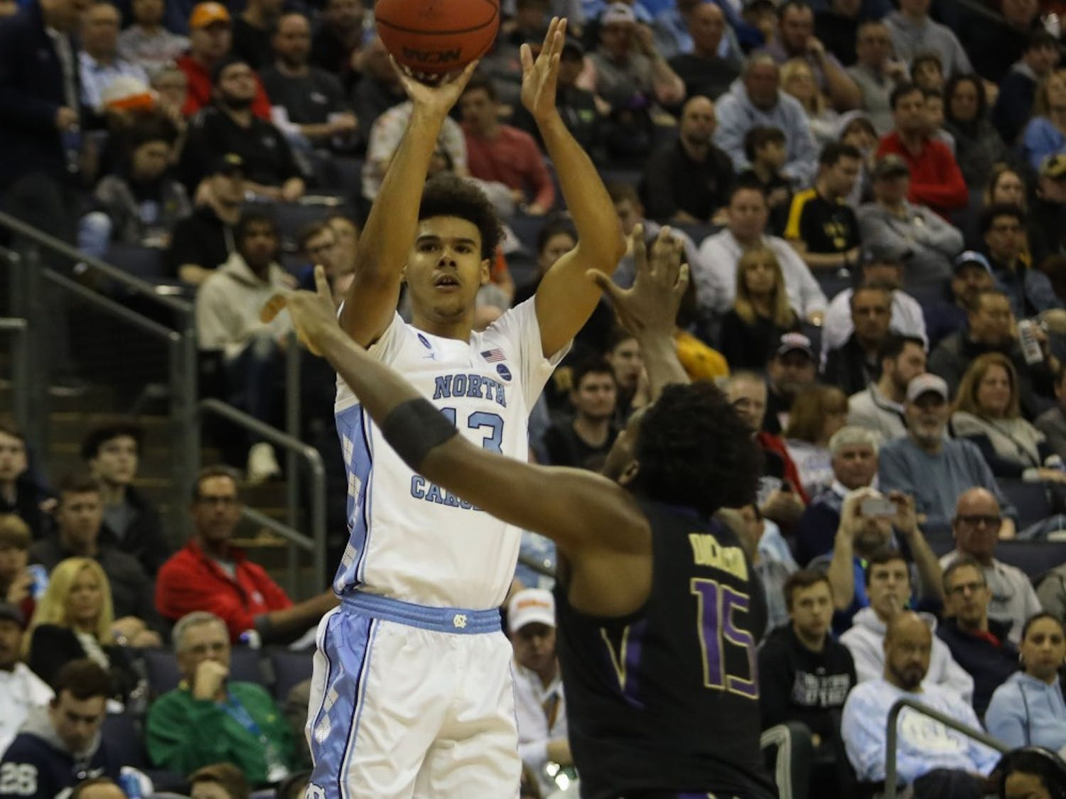 Graduate guard Cam Johnson (13) shoots a three-pointer against Washington in the second round of the NCAA tournament at Nationwide Arena in Columbus, OH on Sunday, March 24, 2019. UNC defeated Washington 81-59. Johnson scored 13 points for the Tar Heels.