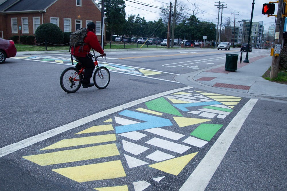 Local artists bring color and brightness to nearby crosswalks