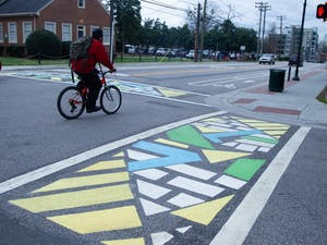 Newly created paintings are pictured on Feb. 10, 2020, on display at the intersection of Rosemary and Church Streets.