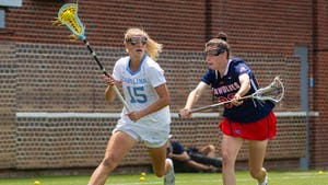 UNC senior attacker Scottie Rose Growney (15) runs with the ball at the quarterfinals of the NCAA tournament against Stony Brook at the Dorrance Field in Chapel Hill on Saturday May 22, 2021. The Tar Heels won 14-11.