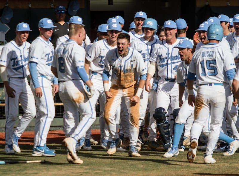 UNC shortstop junior Ike Freeman (8) celebrates with the UNC baseball team after hitting a homerun against South Florida Sunday, Feb. 24, 2019 at Boshamer Stadium.  Freeman went 3-4 with 4 RBI.