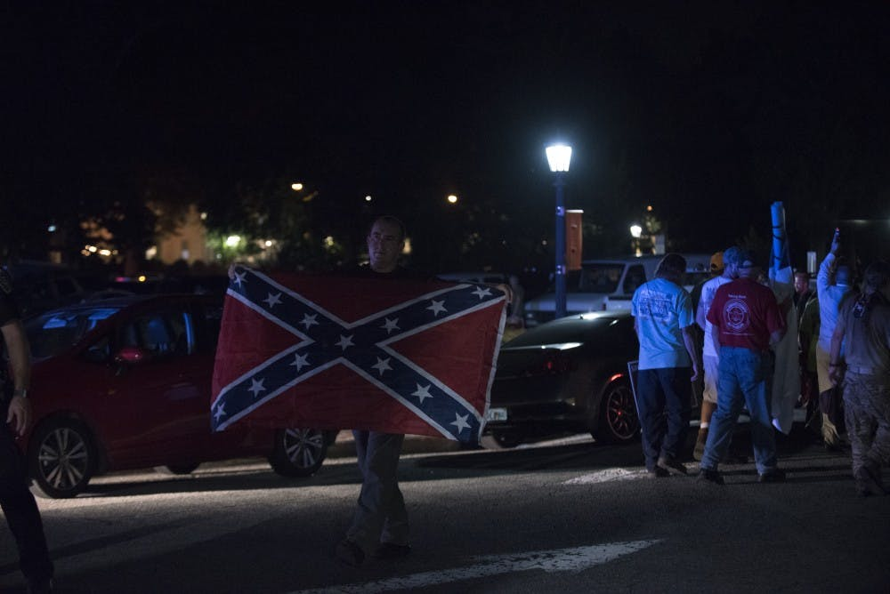 During Silent Sam twilight service and dance party, police