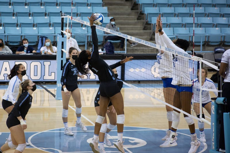 Junior redshirt Destiny Cox (1) sends the ball to the Duke Blue Devils in Carmichael Arena on Sunday, Oct. 11, 2020. The Blue Devils beat the Tar Heels 3-1.