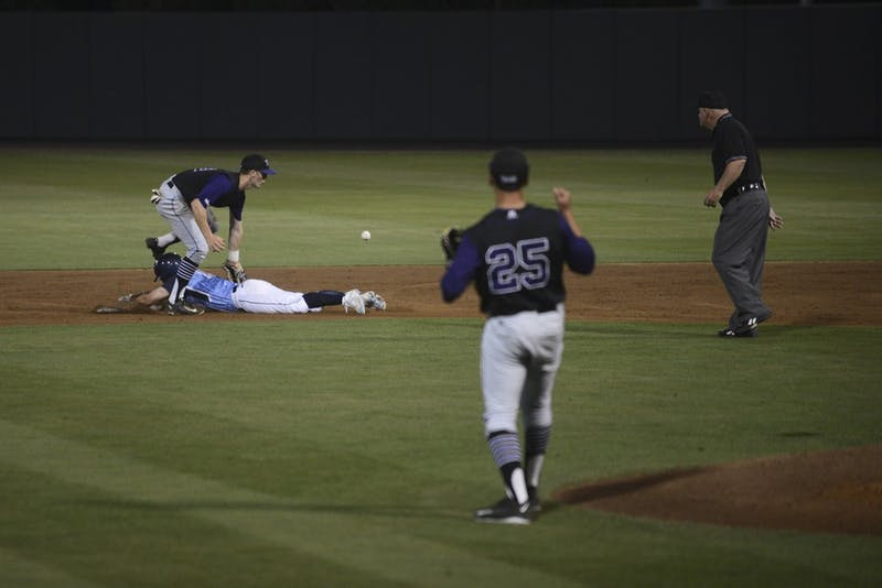 UNC sophomore Tyler Ramirez (14) safely steals second after knocking the ball lose in Tuesday's game against High Point.