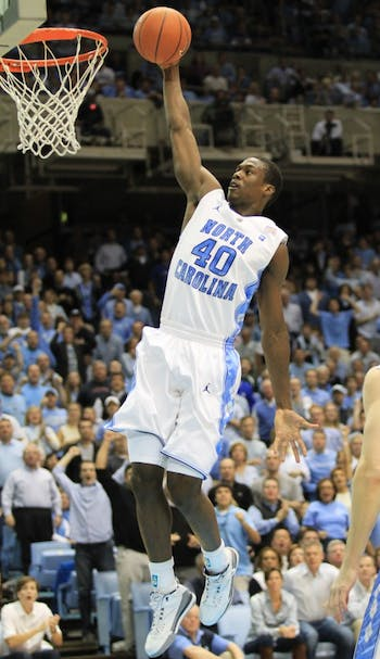 UNC's Harrison Barnes goes up for a dunk in UNC's 75-73 win against Kentucky. The preseason All-American finished the game with 12 points.