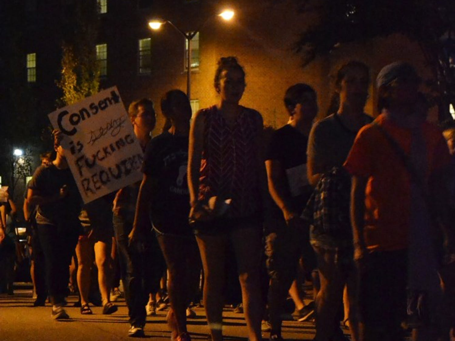 Protesters chant angrily in protest of Title IX on the way to the Department of Public Health and Safety.