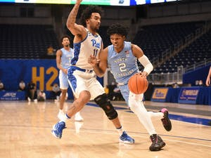 UNC first year guard Caleb Love (2) drives toward the basket during a game against Pitt on Tuesday, Jan. 26, 2021. UNC beat Pitt 75-65. Photo courtesy of Matthew Hawley.
