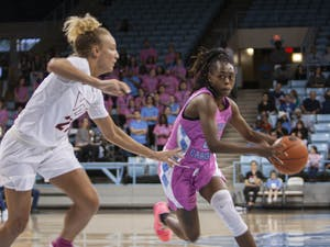 Senior guard Shayla Bennett (22) runs upcourt at the Carmichael Arena in a game against Virginia Tech on Sunday, Feb. 9, 2020. Bennett scored a career-high 26 points and eight rebounds. UNC lost to Virginia Tech 72-63.