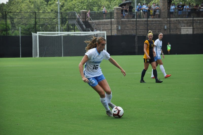 Defender (16) Julia Ashley dribbles down the field during Sunday's win against Marquette.