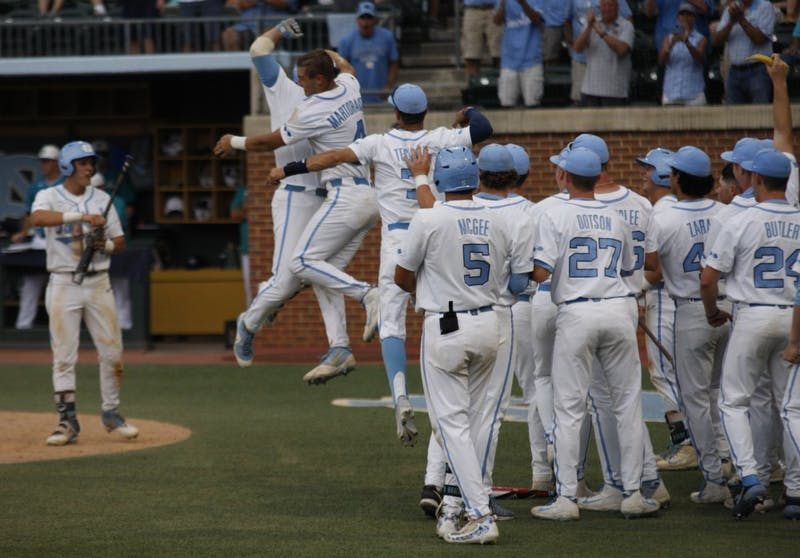 UNC baseball players celebrate after a big home run in the bottom of the ninth during the first round of the regional championships versus UNCW. UNC won 7-6.