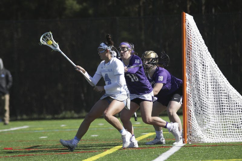 UNC midfielder (4) Marie McCool moves in the crease against James Madison on Saturday at Cardinal Gibbons High School in Raleigh.