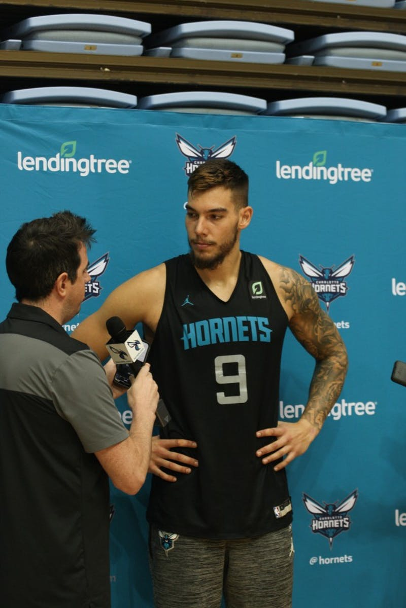 Charlotte Hornets Center Willy Hernangomez (9) is interviewed by members of the media after training camp practice in the Dean E. Smith Center on Friday, Oct. 4, 2019.