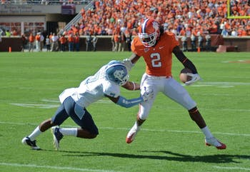 Clemson wide receiver, Sammy Watkins, avoids Carolina defensive back Tim Scott. UNC lost 38-59.