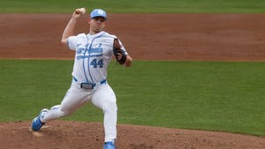 UNC redshirt sophomore starting pitcher Austin Love delivers a pitch during Carolina's 8-1 season-opening victory over James Madison at Boshamer Stadium, Feb. 19, 2021.