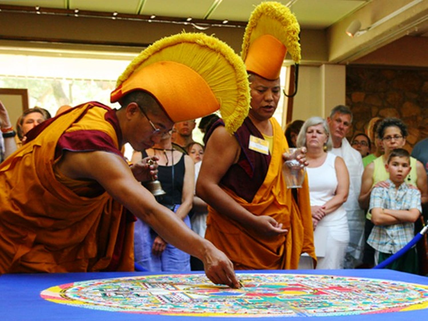 Tibetan monks from Drepung Gomang Monastery in South India deconstruct their Sacred Sand Mandala during the closing ceremony Monday.