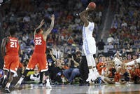 UNC forward Joel James (42) shoots the ball during the semi-final NCAA tournament game against Syracuse.
