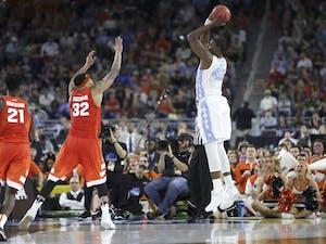 UNC forward Joel James (42) shoots the ball during the semi-final NCAA tournament game against Syracuse.