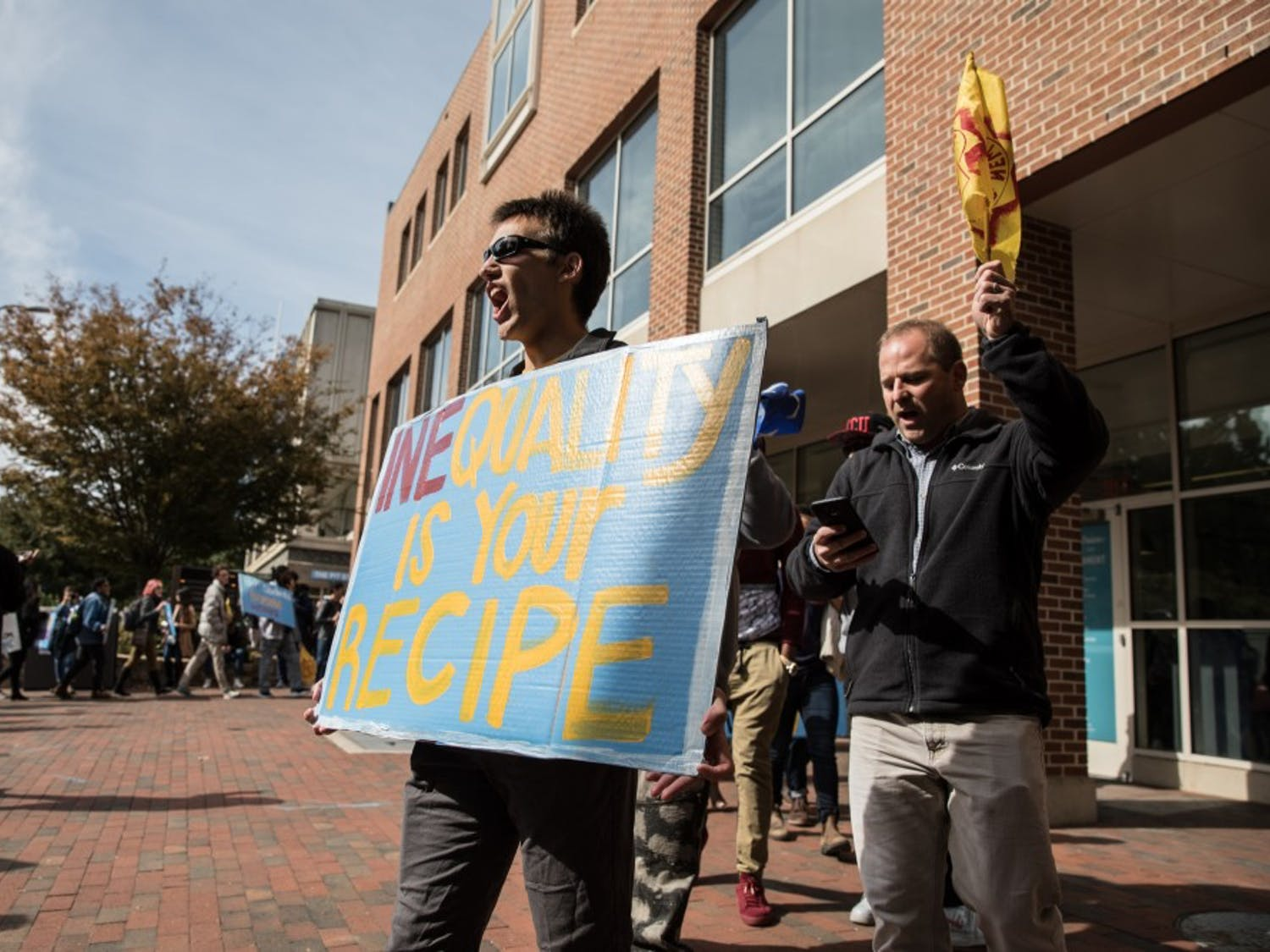 Student activists from the UNC Student/Farmworker Alliance protest Wendy's  in front of  the Wendy's in the bottom of the Frank Porter Graham Student Union in on Thursday, Oct. 25, in Chapel Hill, NC. The student alliance demanded the removal of Wendy's from the campus due to the alleged injustices and human rights abuses of farmworkers through the Fair Food Program.