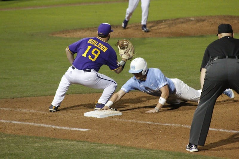 UNC's first baseman Michael Busch (15) slides back to first base during Saturday's game against East Carolina University, where UNC won 5-4.