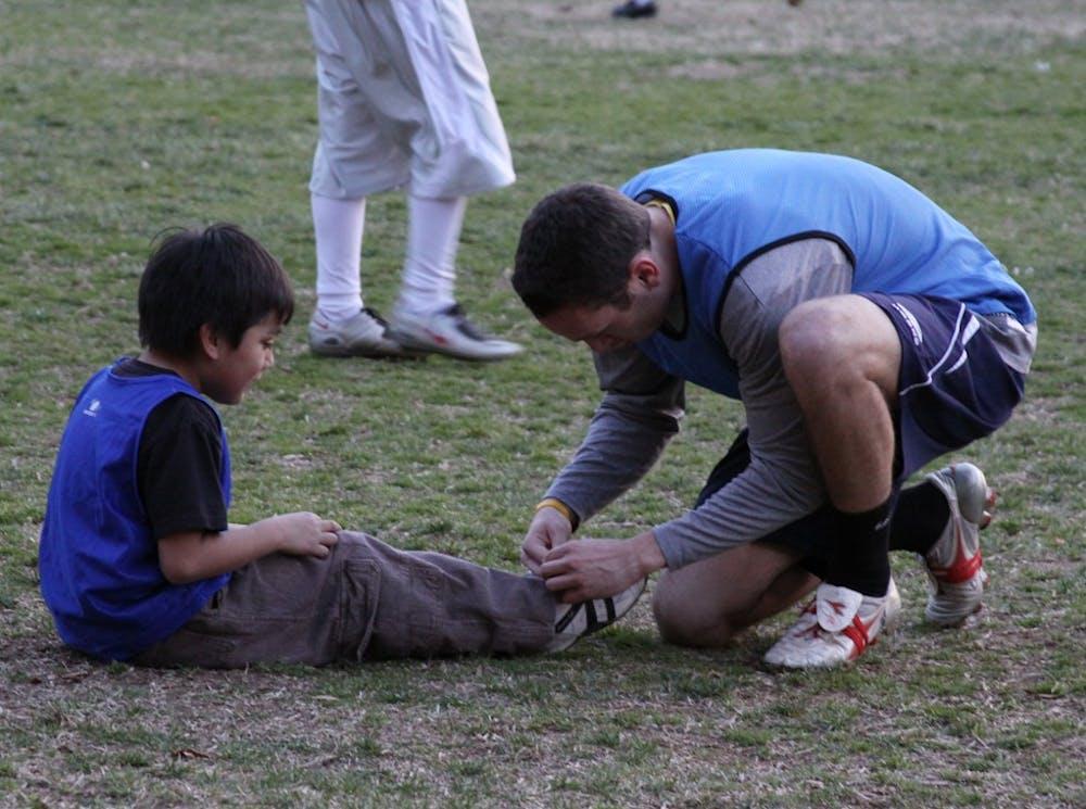 Abbey Court children, UNC students find common bond in soccer