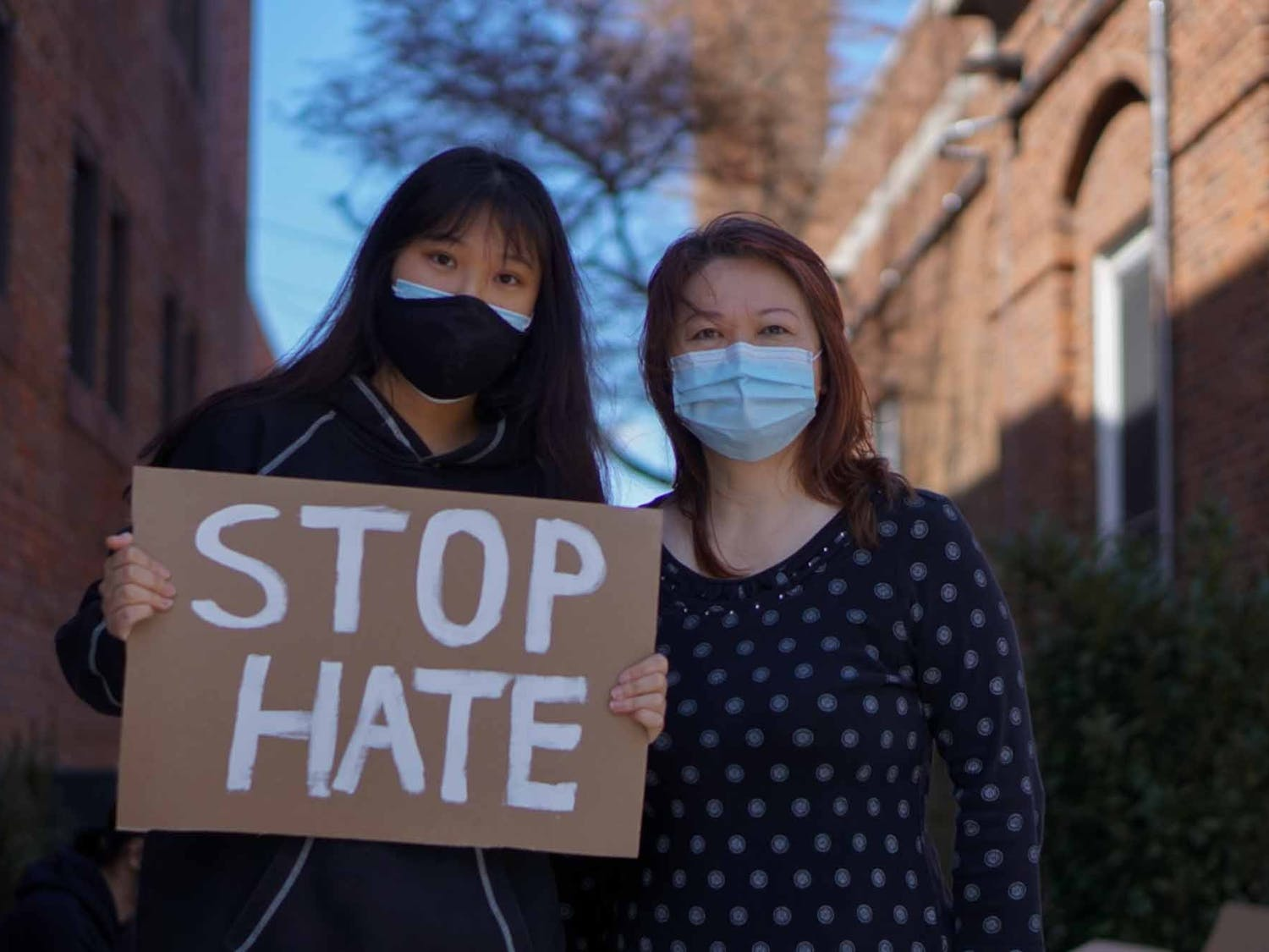 Tiffany Tan and her mother Winnie Tong honor and remember the victims if the shootings in Atlanta at the Peace and Justice Plaza along with The Chinese American Friendship Association and North Carolina Asian Americans Together on Sunday, March 21, 2021.