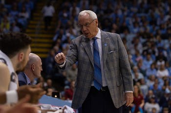 Head Coach Roy Williams speaks to the bench during the game against Boston College in the Smith Center on Saturday, Feb. 1, 2020. UNC lost to Boston College 71-70.