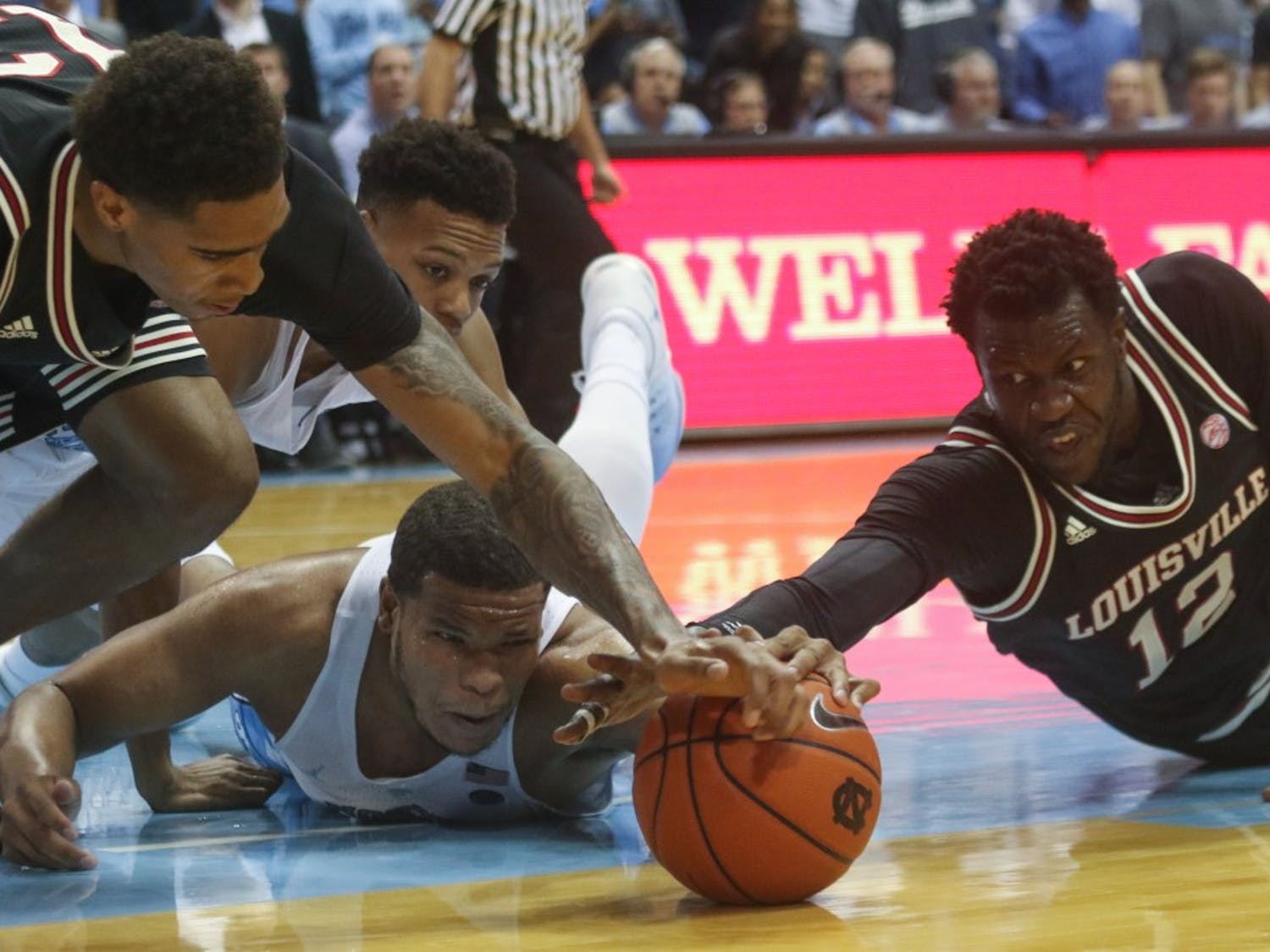 North Carolina forward Kennedy Meeks (3) dives for a loose ball against Louisville on Feb. 23, 2017.