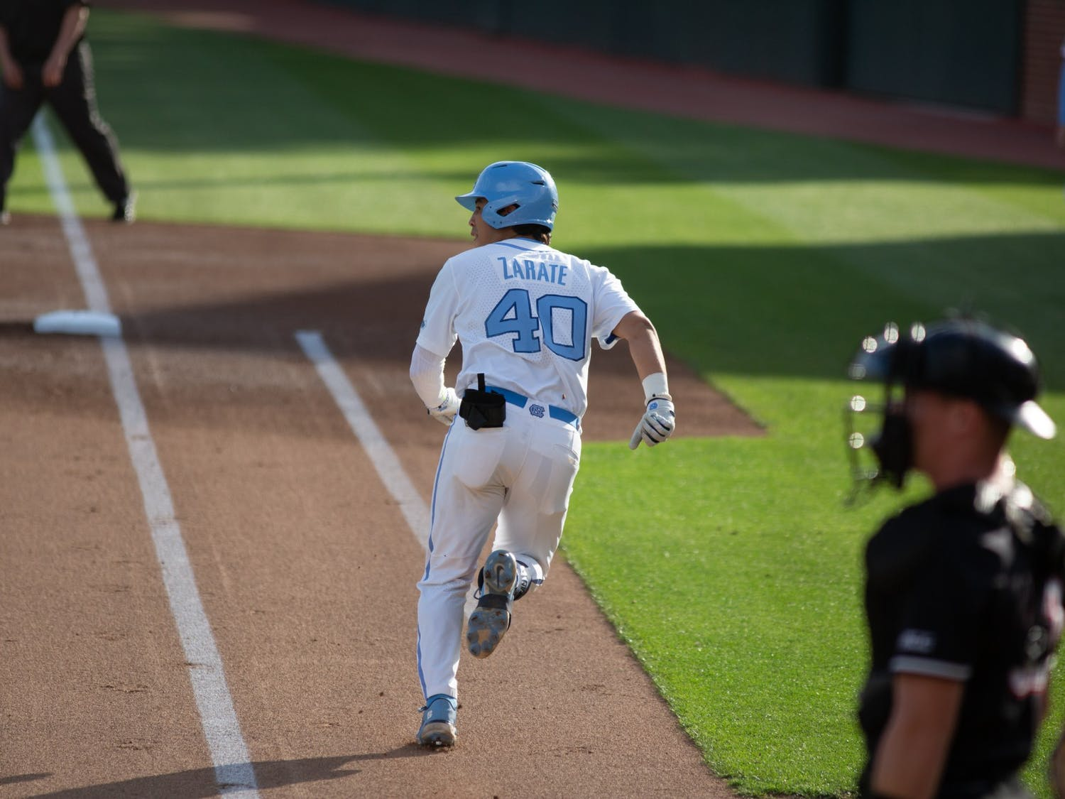 Redshirt sophomore Angel Zarate (40) approaches first base in a game against Louisville on Friday, May 14, 2021. The Tar Heels beat the Cardinals 5-1.