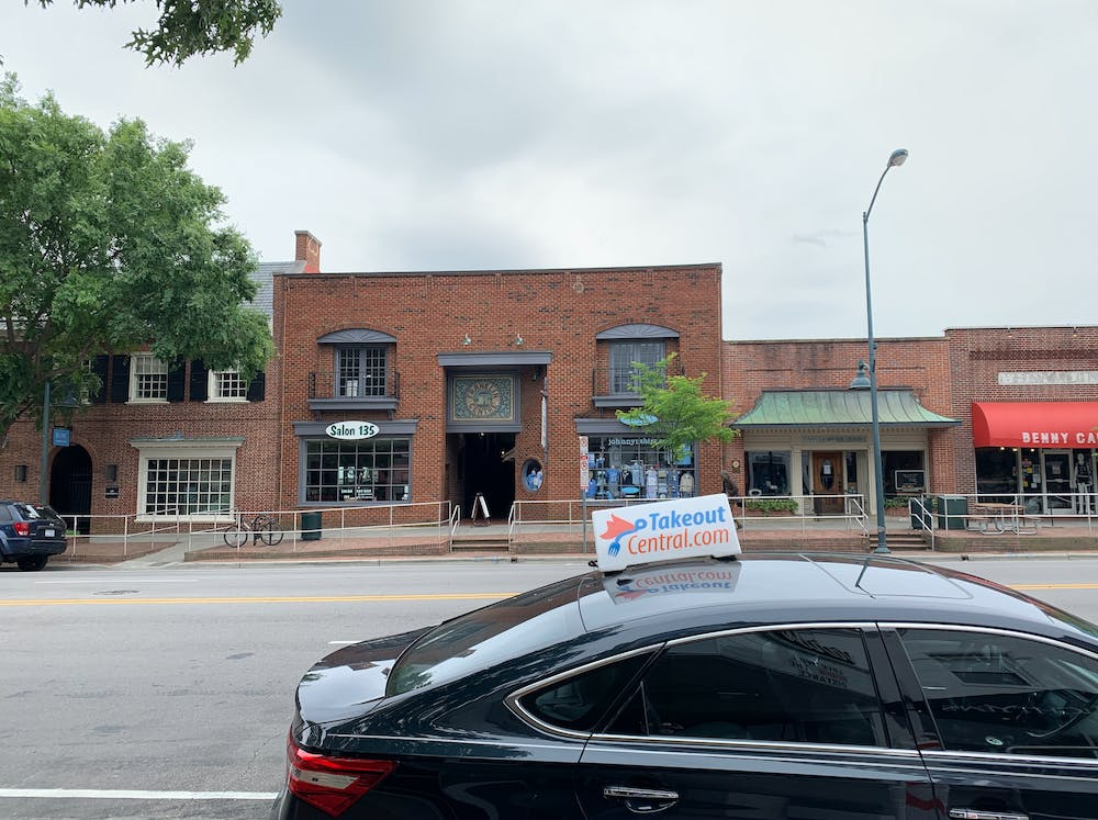 <p>A Takeout Central delivery vehicle is parked on Franklin St. in Chapel Hill on Friday, May 8, 2020.</p>