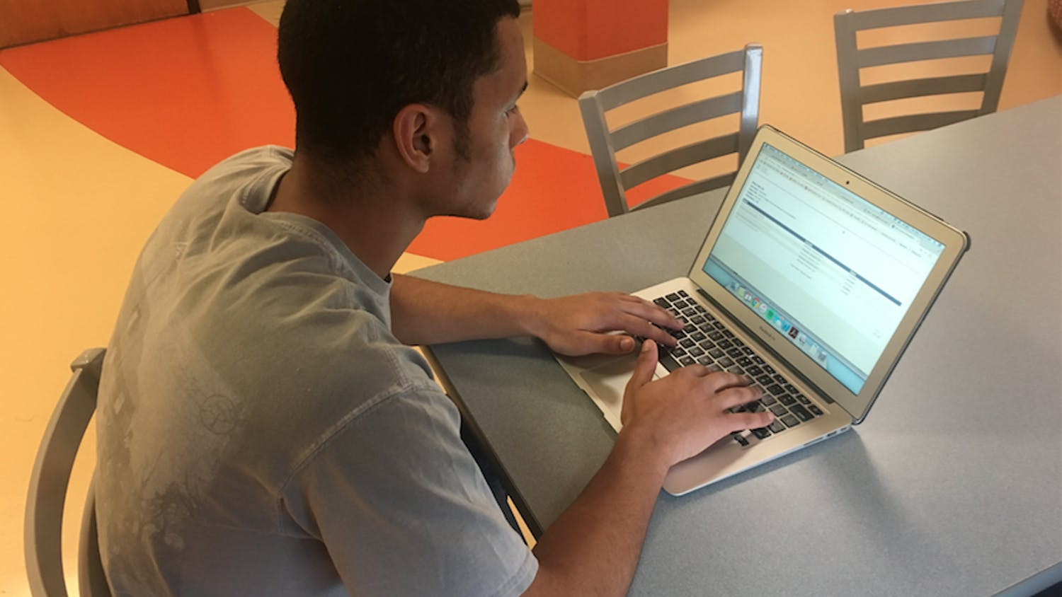 Alec White, a first-year at the time, fills out a course evaluation for the Fall 2017 semester. The Committee on Community and Diversity discussed the impact of COVID-19 on faculty teaching evaluations and the upcoming faculty nomination process over Zoom on Friday, Jan. 8, 2021.