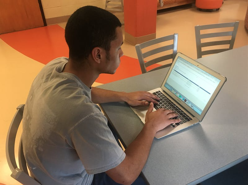 First-year Alec White fills out course evaluation.