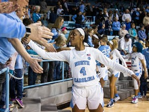 UNC freshman guard Kennady Tucker (4) high-fives fans after the game against Duke University in Carmichael Arena on Sunday, March 1, 2020. The Blue Devils beat the Tar Heels 73-54.