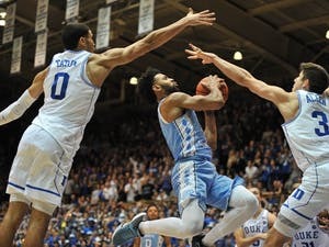 North Carolina guardJoel Berry (2) is blocked by two Duke defenders during the second half of the game on Thursday evening.