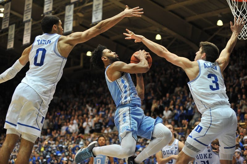 North Carolina guard Joel Berry (2) is blocked by two Duke defenders during the second half of the game on Thursday evening.