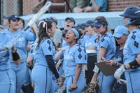 Sophomore Hailey Jensen (3) and junior Kiani Ramsey (8) celebrate against N.C. State on April 13 at Anderson Stadium.