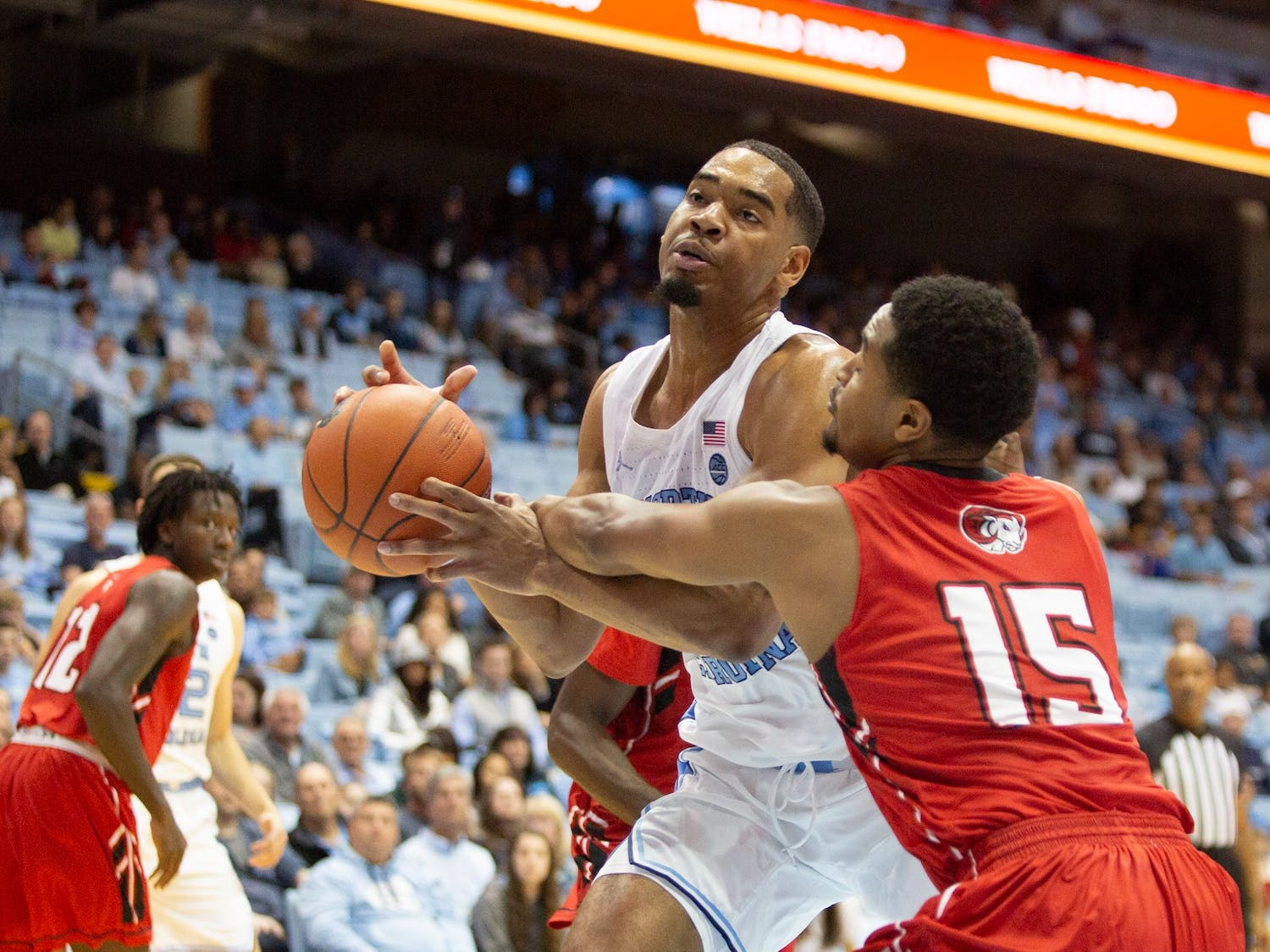 Winston-Salem State junior Glen Campbell (15) guards UNC junior forward Garrison Brooks (15) at the exhibition game on Friday, Nov. 1, 2019 in the Smith Center. UNC won 96-61.