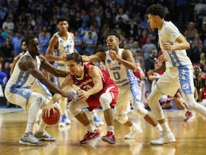 The North Carolina basketball team swarms Arkansas guard Dusty Hannahs (3) leading to a turnover in the second round of the NCAA Tournament in Greenville on Sunday.