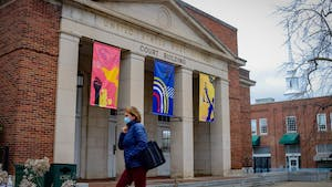 New banners with artwork designed by Triangle artist Victoria Primicias have been hung in the Justice Plaza on Franklin Street.