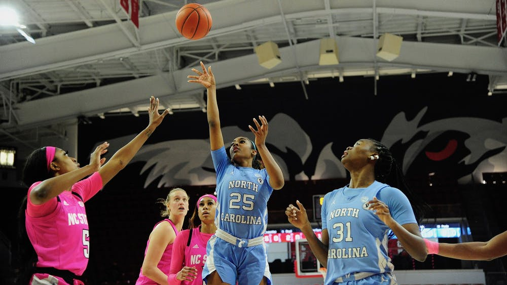 UNC first year guard Deja Kelly (25) takes a shot during a game against NC State in Reynolds Coliseum on Sunday, February 21, 2021. Photo courtesy of Dana Gentry.