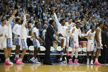 The UNC bench celebrates a basket against Miami on Saturday, Feb. 9, 2019 in the Smith Center. UNC men's basketball defeated Miami 88-85 in overtime.