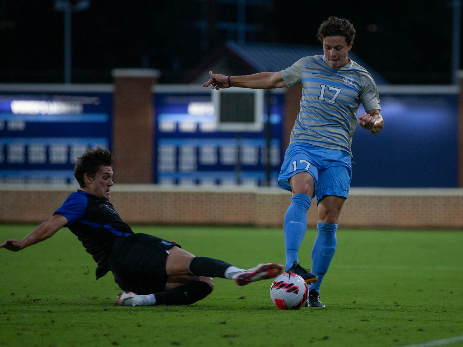 Third-year Cameron Fisher (17) fights for the ball during the game against Duke at Dorrance Field on Sunday, Sept. 19. UNC lost 3-0.