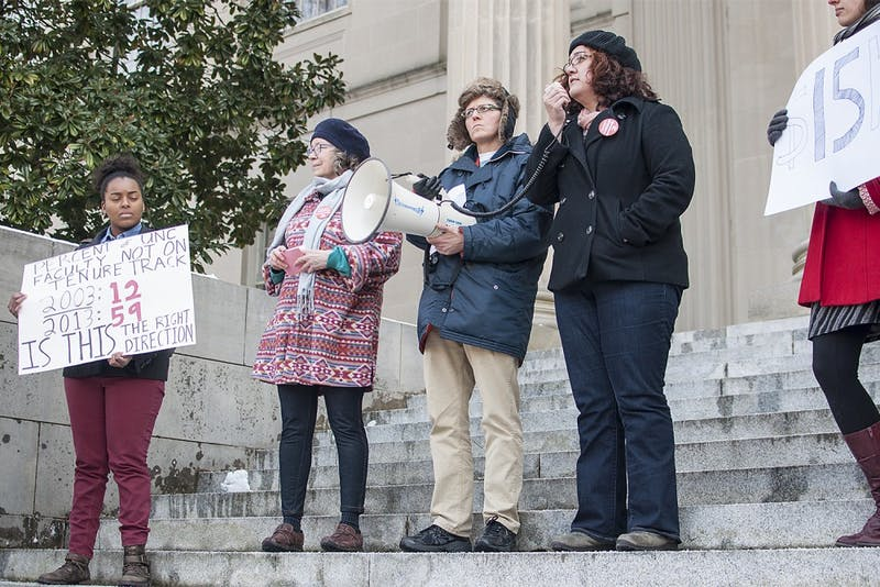 Didem Turkoglu (right), a teaching assistant and doctoral candidate in the sociology department, spoke at the rally Wednesday.