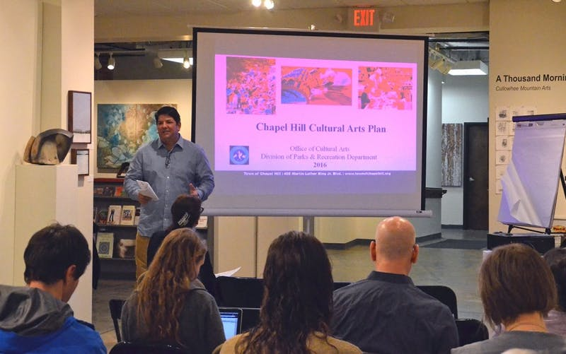 Dan Cefalo, chairperson of the Chapel Hill Public Arts Commission, takes suggestions for how to improve the arts in Chapel Hill at the FRANK Gallery on Tuesday.