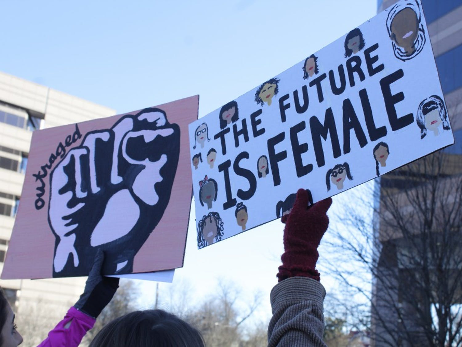Marchers carry homemade signs during Saturday's rally in Raleigh. There was also a march in Hillsborough.