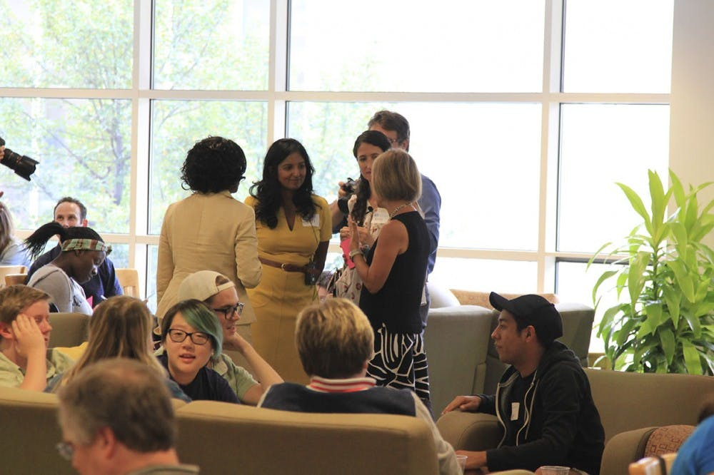 Rumay Alexander (far left), Dr. Viji Sathy (left),  Dr. Kelly Hogan (right), and Chancellor Carol Folt converse at the Carolina Conversations while students, faculty, and staff do the same in small groups on Monday in the Aquarium Lounge at the Student Union.