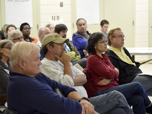 The Town of Chapel Hill held a Open House on October 28th to update residents of Northside on the towns initiatives and partnerships within the Northside Neighborhood. Attendees listen as others in the crowd address organizers about some of the initiatives.