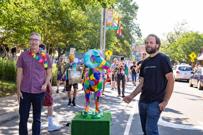Carrboro Mayor Pro Tem Damon Seils and Alderman Sammy Slade lead the crowd with Rainbow Ram at the Pride Piper March on Saturday, June 1.