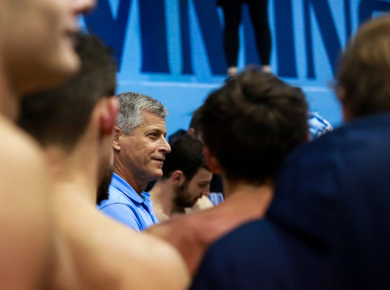 Head coach Rich DeSelm addresses the swim and dive teams after the home meet against Virginia in Koury Natatorium on Friday, January 25, 2019.  Both women and men lost to Virginia.